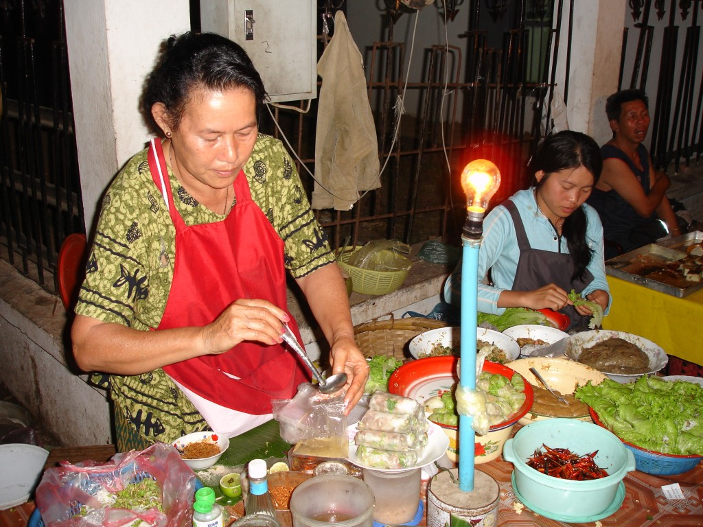 Fresh spring rolls being prepared at Luang Prabang night market, Laos