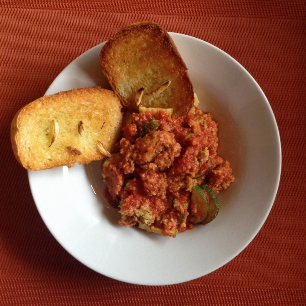 Falafel in tomato sauce with zucchini and garlic bread