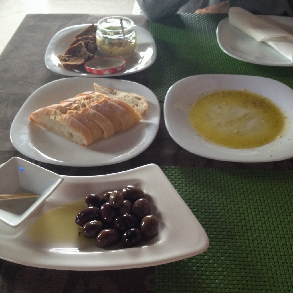 Olive oil, olives and fresh bread