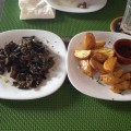Mushrooms sauteed in olive oil and rosemary wedges with home-made tomato sauce